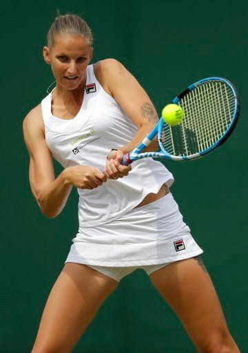 (AP Photo/Ben Curtis). Karolina Pliskova of the Czech Republic returns the ball to Kiki Bertens of the Netherlands during their women's singles match on the seventh day at the Wimbledon Tennis Championships in London, Monday July 9, 2018.