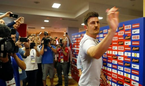 (AP Photo/Alastair Grant). England's Harry Maguire plays a game of darts as the media looks on before a press conference for the England team at the 2018 soccer World Cup, in Repino near St. Petersburg, Russia, Monday, July 9, 2018.