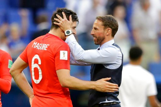 (AP Photo/Matthias Schrader ). England head coach Gareth Southgate, right, celebrates victory of his team over Sweden with England's Harry Maguire during the quarterfinal match between Sweden and England at the 2018 soccer World Cup in the Samara Arena...