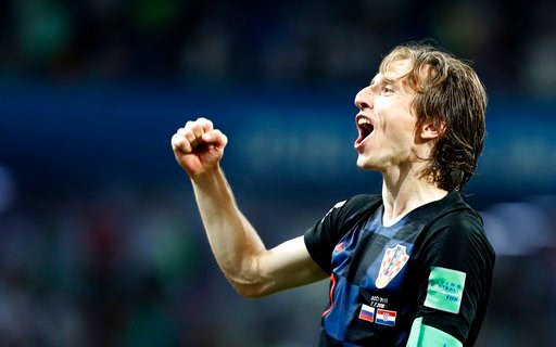 (AP Photo/Rebecca Blackwell). Croatia's Luka Modric celebrates after winning the quarterfinal match between Russia and Croatia at the 2018 soccer World Cup in the Fisht Stadium, in Sochi, Russia, Saturday, July 7, 2018.