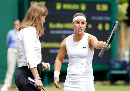 (AP Photo/Kirsty Wigglesworth). Dominika Cibulkova of Slovakia speaks to a match official after a line call during the women's singles match against Su-Wei Hsieh of Taiwan on the seventh day at the Wimbledon Tennis Championships in London, Monday July ...