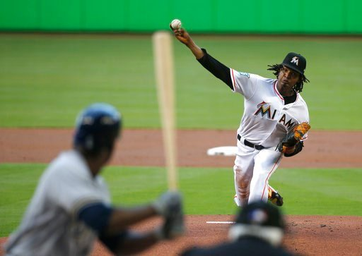(AP Photo/Wilfredo Lee). Miami Marlins' Jose Urena, right, pitches to Milwaukee Brewers' Lorenzo Cain during the first inning of a baseball game, Monday, July 9, 2018, in Miami.