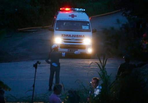 (AP Photo/Sakchai Lalit). One of two ambulances with flashing lights leaves the cave rescue area in Mae Sai, Chiang Rai province, northern Thailand, Monday, July 9, 2018.