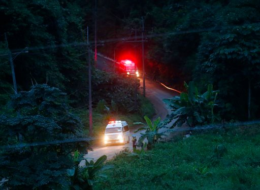 (AP Photo/Sakchai Lalit). Two ambulances with flashing lights leaves the cave rescue area in Mae Sai, Chiang Rai province, northern Thailand, Monday, July 9, 2018.
