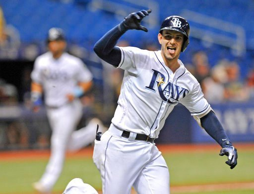 (AP Photo/Steve Nesius). Tampa Bay Rays' Daniel Robertson gestures toward the dugout after hitting a walk-off RBI-single off Detroit Tigers reliever Blaine Hardy to score Kevin Kiermaier, left, during the 10th inning of a baseball game Monday, July 9, ...