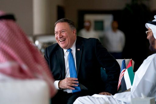 (AP Photo/Andrew Harnik, Pool). U.S. Secretary of State Mike Pompeo, center, and Abu Dhabi's Crown Prince Sheikh Mohammed bin Zayed Al Nahyan, right, laugh together as they meet at the Al Shati Palace in Abu Dhabi?, United Arab Emirates, Tuesday, July ...