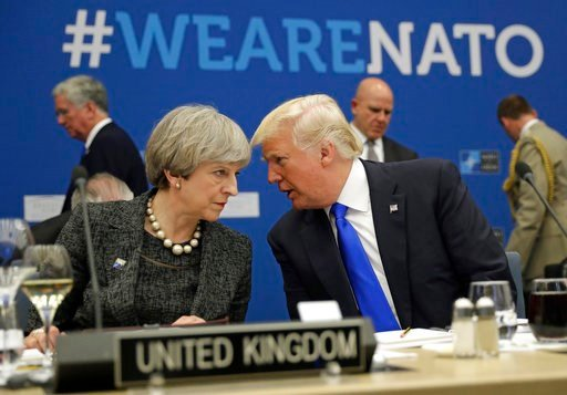 (AP Photo/Matt Dunham, Pool, File). FILE -In this Thursday, May 25, 2017 file photo, British Prime Minister Theresa May, left, speaks to U.S. President Donald Trump during a NATO summit at NATO headquarters in Brussels. When Donald Trump walks into a N...