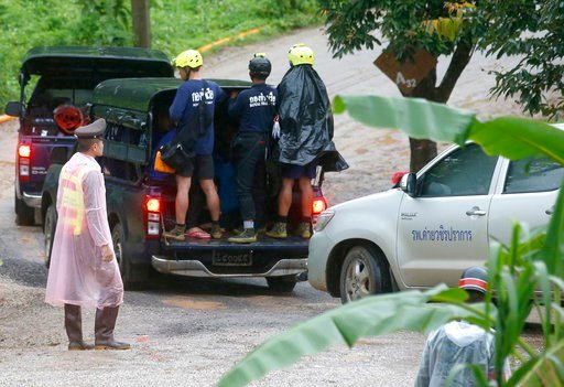 (AP Photo/Sakchai Lalit). Rescuers move to the entrance to a cave complex where five stil lwere trapped in Mae Sai, Chiang Rai province, northern Thailand Tuesday, July 10, 2018. The eight boys were rescued from the flooded cave.