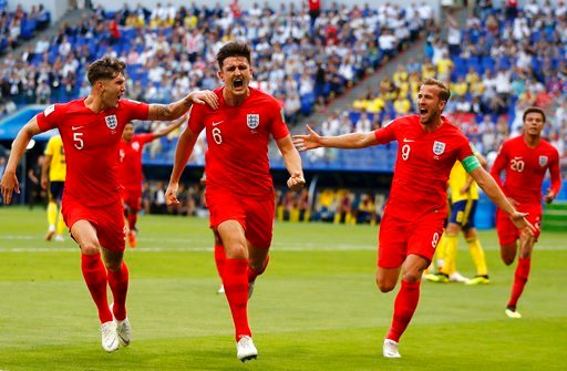 (AP Photo/Francisco Seco). England's Harry Maguire, center, celebrates with his teammates after scoring his side opening goal during the quarterfinal match between Sweden and England at the 2018 soccer World Cup in the Samara Arena, in Samara, Russia, ...
