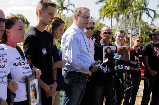 (Jose A. Iglesias/Miami Herald via AP, File). FILE - This March 5, 2018 file photo shows Ryan Petty, center, father of slain student Alaina Petty, at a news conference surrounded by other parents of the victims of the fatal Valentine's Day shooting at ...