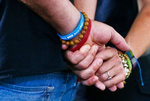 (AP Photo/Brynn Anderson, File). FILE - In a Tuesday, June 5, 2018 file photo, Manuel and Patricia Oliver, parents of Parkland High School shooting victim Joaquin Oliver, hold hands as they speak to the media in Miami during a news conference reacting ...