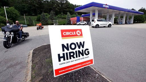 """(AP Photo/Charles Krupa). In this June 20, 2018, photo, a """"Now Hiring"""" sign is posted outside a gas station in Raymond, N.H. On Tuesday, July 10, the Labor Department reports on job openings and labor turnover for May."""