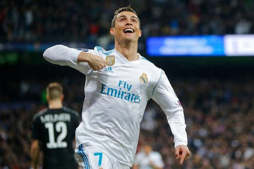 (AP Photo/Paul White, File). FILE - In this Wednesday, Feb. 14, 2018 file photo Real Madrid's Cristiano Ronaldo celebrates his side's 2nd goal during the Champions League soccer match, round of 16, 1st leg between Real Madrid and Paris Saint Germain at...