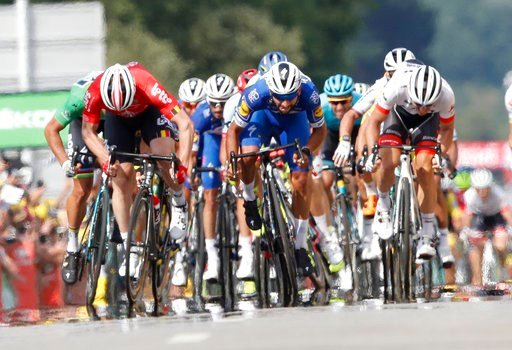 (AP Photo/Christophe Ena ). Colombia's Fernando Gaviria, center, sprints to win the fourth stage of the Tour de France cycling race over 195 kilometers (121 miles) with start in La Baule and finish in Sarzeau, France, Tuesday, July 10, 2018.