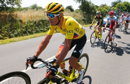 (AP Photo/Peter Dejong). Belgium's Greg van Avermaet, wearing the overall leader's yellow jersey rides in the pack during the fourth stage of the Tour de France cycling race over 195 kilometers (121 miles) with start in La Baule and finish in Sarzeau, ...