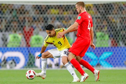 (AP Photo/Ricardo Mazalan). Colombia's Radamel Falcao, left, vies for the ball with England's Eric Dier during the round of 16 match between Colombia and England at the 2018 soccer World Cup in the Spartak Stadium, in Moscow, Russia, Tuesday, July 3, 2...