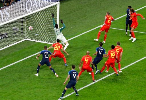 (AP Photo/Thanassis Stavrakis). France's Samuel Umtiti, 2nd right, scores the opening goal during the semifinal match between France and Belgium at the 2018 soccer World Cup in the St. Petersburg Stadium in St. Petersburg, Russia, Tuesday, July 10, 2018.