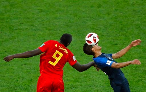 (AP Photo/Pavel Golovkin). Belgium's Romelu Lukaku, left, jumps for the ball with France's Raphael Varane during the semifinal match between France and Belgium at the 2018 soccer World Cup in the St. Petersburg Stadium in St. Petersburg, Russia, Tuesda...