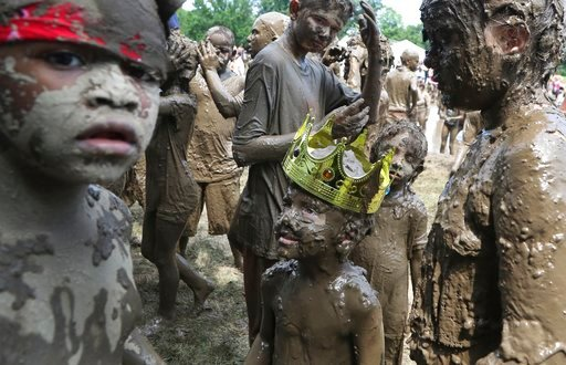 (AP Photo/Carlos Osorio). Charles Daviskiba, 3, is seen after being crowned Mud Day King during Mud Day at the Nankin Mills Park, Tuesday, July 10, 2018, in Westland, Mich. The event marked the 31st year Wayne County Parks has hosted the event. While m...
