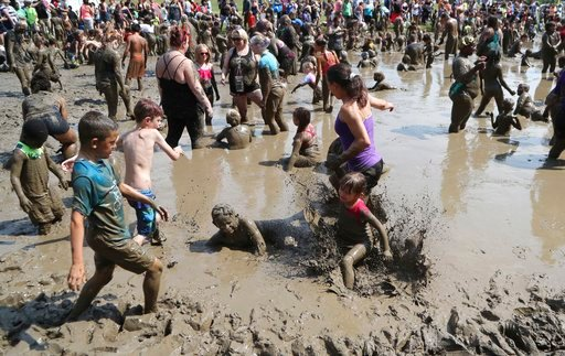 (AP Photo/Carlos Osorio). Hundreds of kids play in the mud pit during Mud Day at the Nankin Mills Park, Tuesday, July 10, 2018, in Westland, Mich. The event marked the 31st year Wayne County Parks has hosted the event. While much of the event was child...