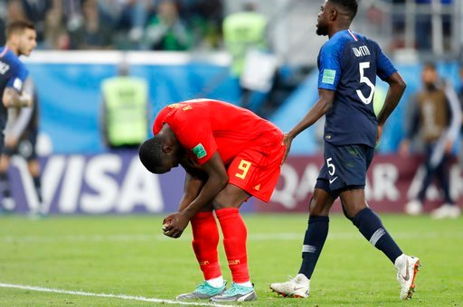 (AP Photo/David Vincent). Belgium's Romelu Lukaku reacts after missing a scoring chance during the semifinal match between France and Belgium at the 2018 soccer World Cup in the St. Petersburg Stadium, in St. Petersburg, Russia, Tuesday, July 10, 2018.