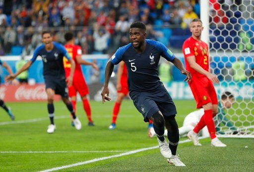 (AP Photo/Natacha Pisarenko). France's Samuel Umtiti celebrates after scoring his sides 1st goal of the game during the semifinal match between France and Belgium at the 2018 soccer World Cup in the St. Petersburg Stadium in, St. Petersburg, Russia, Tu...