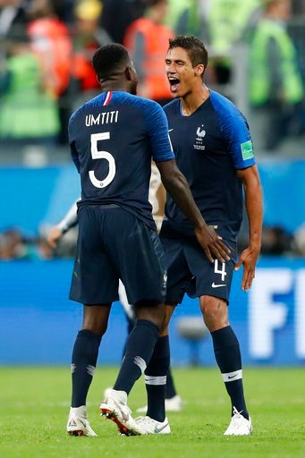 (AP Photo/Frank Augstein). France's Samuel Umtiti, left, and France's Raphael Varane celebrate after the semifinal match between France and Belgium at the 2018 soccer World Cup in the St. Petersburg Stadium in, St. Petersburg, Russia, Tuesday, July 10,...