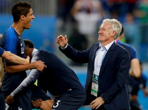 (AP Photo/Petr David Josek). France head coach Didier Deschamps, right, and Raphael Varane celebrate at the end of the semifinal match between France and Belgium at the 2018 soccer World Cup in the St. Petersburg Stadium, in St. Petersburg, Russia, Tue...