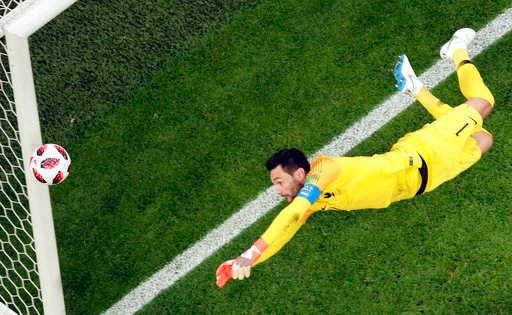 (AP Photo/Dmitri Lovetsky). France goalkeeper Hugo Lloris goes for the ball during the semifinal match between France and Belgium at the 2018 soccer World Cup in the St. Petersburg Stadium in St. Petersburg, Russia, Tuesday, July 10, 2018.