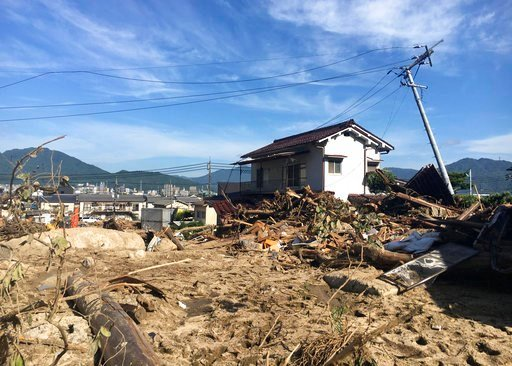 (AP Photo/Haruka Nuga). Destroyed houses are covered with mud at a damaged area in Hiroshima, southwestern Japan, Wednesday, July 11, 2018. Rescuers were combing through mud-covered hillsides and along riverbanks Tuesday searching for dozens of people ...