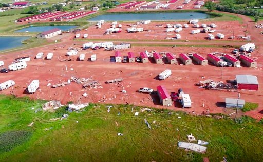 (HRI Aerial Imaging via AP). This aerial image from video, shot with a drone provided by HRI Aerial Imaging, shows damage at an RV park Tuesday, July 10, 2018, in Watford City, N.D., after a violent storm whipped through northwestern North Dakota.