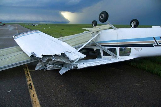 (Taylor Ordahl/Brooks Photography via AP). This Monday, July 9, 2018, evening photo provided by Brooks Photography shows a 175 Cessna plane upside down at the airport in Plentywood, Mont.