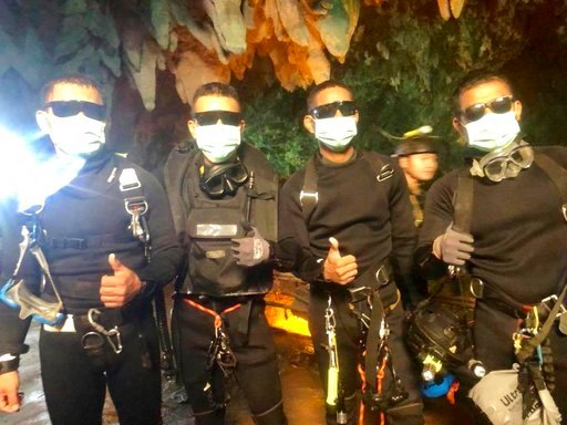(Royal Thai Navy via AP). In this undated photo released by Royal Thai Navy on Tuesday, July 10, 2018, show the last four Thai Navy SEALs come out safely after completing the rescued mission inside a cave where 12 boys and their soccer coach were trapped.