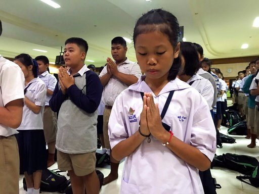 (AP Photo/Johnson Lai). Students pray at Maesaiprasitsart school where six out of the rescued 12 boys study as they cheer the successful rescue in the Mae Sai district in Chiang Rai province, northern Thailand, Wednesday, July 11, 2018.