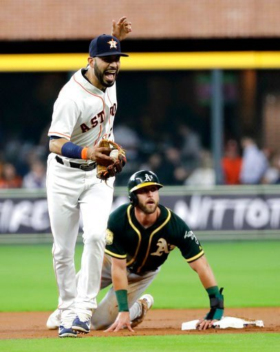(AP Photo/David J. Phillip). Houston Astros shortstop Marwin Gonzalez, left, reacts after tagging out Oakland Athletics' Dustin Fowler at second base during the first inning of a baseball game Tuesday, July 10, 2018, in Houston. Gonzalez was injured on...