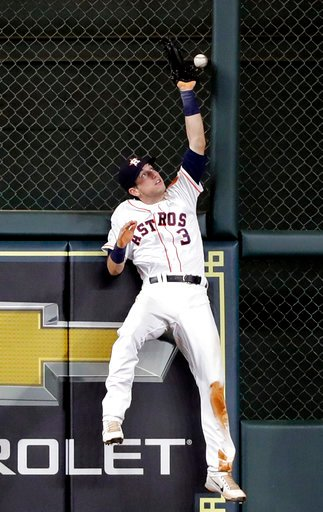(AP Photo/David J. Phillip). Houston Astros left fielder Kyle Tucker tries to catch a triple by Oakland Athletics' Marcus Semien during the fifth inning of a baseball game Tuesday, July 10, 2018, in Houston.