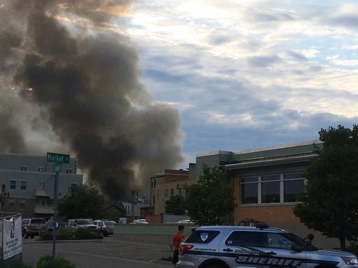 (AP Photo/Todd Richmond). A major fire has broken out with a massive plume of smoke after a loud boom was heard in Sun Prairie, Wis., Tuesday, July 10, 2018.