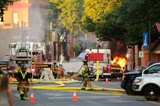 (Amber Arnold/Wisconsin State Journal via AP). Firefighters work the scene of an explosion in downtown Sun Prairie, Wis., Tuesday, July 10, 2018.