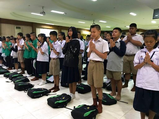 (AP Photo/Johnson Lai). Students pray at Maesaiprasitsart school where six out of the rescued 12 boys study as they cheer the successful rescue in the Mae Sai district in Chiang Rai province, northern Thailand, Wednesday, July 11, 2018. A daring rescue...