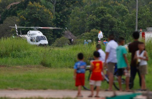 (AP Photo/Vincent Thian). A helicopter believed to be carrying one of the boys rescued from the flooded cave lands in Chiang Rai as divers continue to extract the remaining boys and their coach trapped at Tham Luang cave in the Mae Sai district in Chia...