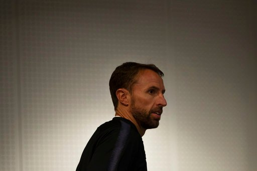 (AP Photo/Francisco Seco). England head coach Gareth Southgate arrives to England's official news conference on the eve of the semifinal match between England and Croatia at the 2018 soccer World Cup in Moscow, Russia, Tuesday, July 10, 2018.