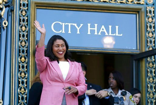 (AP Photo/Lorin Eleni Gill, File). In this June 13, 2018, file photo, London Breed waves before speaking to reporters outside of City Hall in San Francisco.
