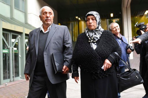 (Tobias Hase/dpa via AP). Aye Yozgat, right, and Ismail Yozgat, left, parents of NSU victim  Halit Yozgat, arrive outside the court in Munich, southern Germany, prior to the verdict Wednesday, July 11, 2018 before a court in Munich is due to conclude i...