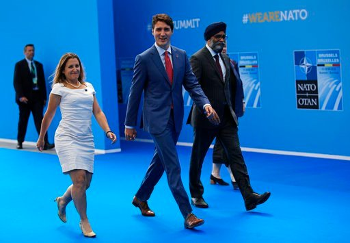 (AP Photo/Francois Mori). Canadian Prime Minister Justin Trudeau, center, arrives for a summit of heads of state and government at NATO headquarters in Brussels on Wednesday, July 11, 2018. NATO leaders gather in Brussels for a two-day summit to discus...