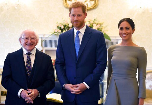 (Clodagh Kilcoyne/PA via AP). Britain's Prince Harry, centre and Meghan, the Duchess of Sussex pose for a photograph with Ireland's President Michael Higgins at Aras an Uactharain, on the second day of the Royal couple's visit to Dublin, Ireland, Wedne...