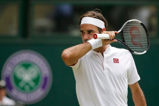 (AP Photo/Tim Ireland). Roger Federer of Switzerland wipes his face during his men's singles match against France's Adrian Mannarino, on day seven of the Wimbledon Tennis Championships, in London, Monday July 9, 2018.