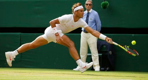 (AP Photo/Tim Ireland). Rafael Nadal of Spain returns the ball to Czech Republic's Jiri Vesely during their men's singles match, on day seven of the Wimbledon Tennis Championships, in London, Monday July 9, 2018.