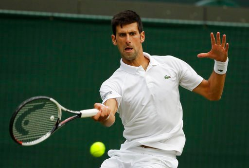 (AP Photo/Kirsty Wigglesworth). Novak Djokovic of Serbia returns the ball to Karen Khachanov of Russia during their men's singles match on the seventh day at the Wimbledon Tennis Championships in London, Monday July 9, 2018.