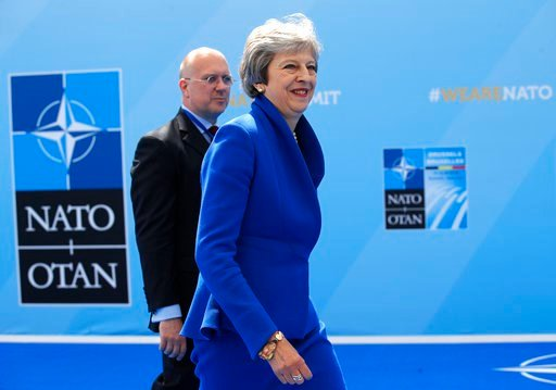 (AP Photo/Francois Mori). British Prime Minister Theresa May smiles as she arrives for a summit of heads of state and government at NATO headquarters in Brussels on Wednesday, July 11, 2018. NATO leaders gather in Brussels for a two-day summit to discu...