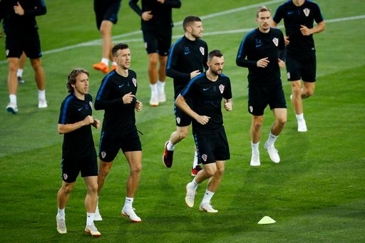 (AP Photo/Francisco Seco). Croatia's Luka Modric, Ivan Perisic, Ante Rebic, Marcelo Brozovic and Filip Bradaric, from left, warm up during a training session in the Luzhniki sport ground at 2018 soccer World Cup in Moscow, Russia, Monday, July 9, 2018.